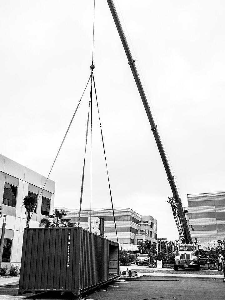 Container Pavilion at Intersect-14-shipping container being craned in