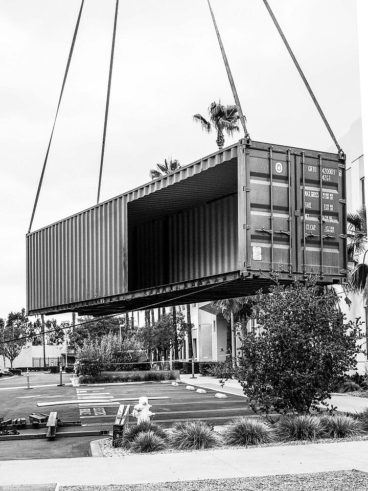 Container Pavilion at Intersect-15-shipping container being craned in