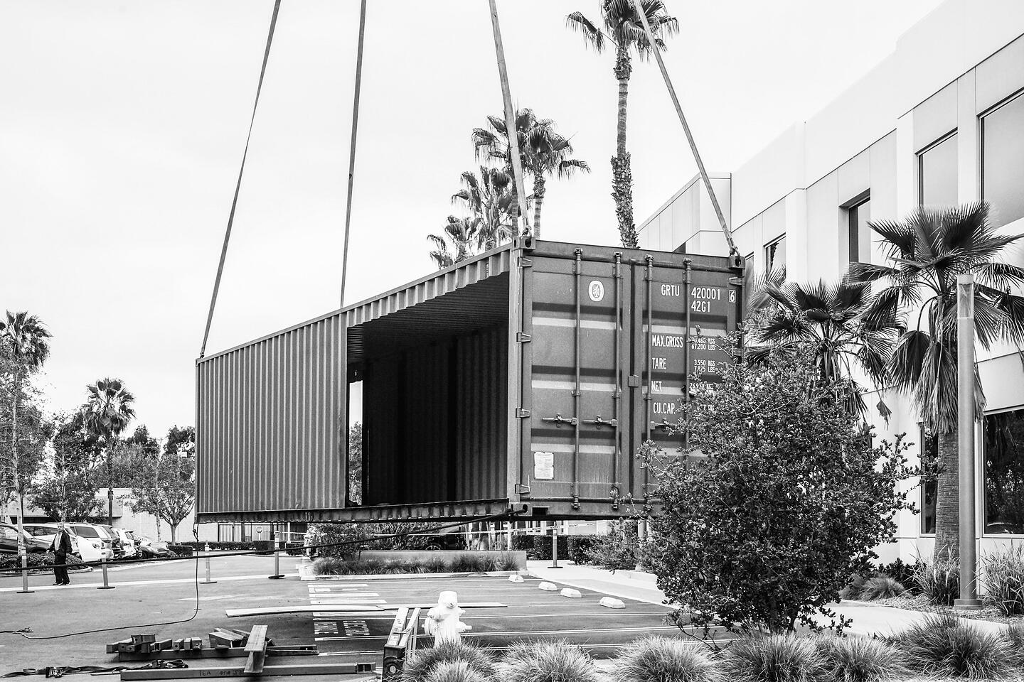 Container Pavilion at Intersect-16-shipping container being craned in