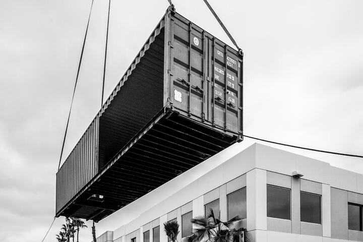 Container Pavilion at Intersect-17-shipping container being craned in