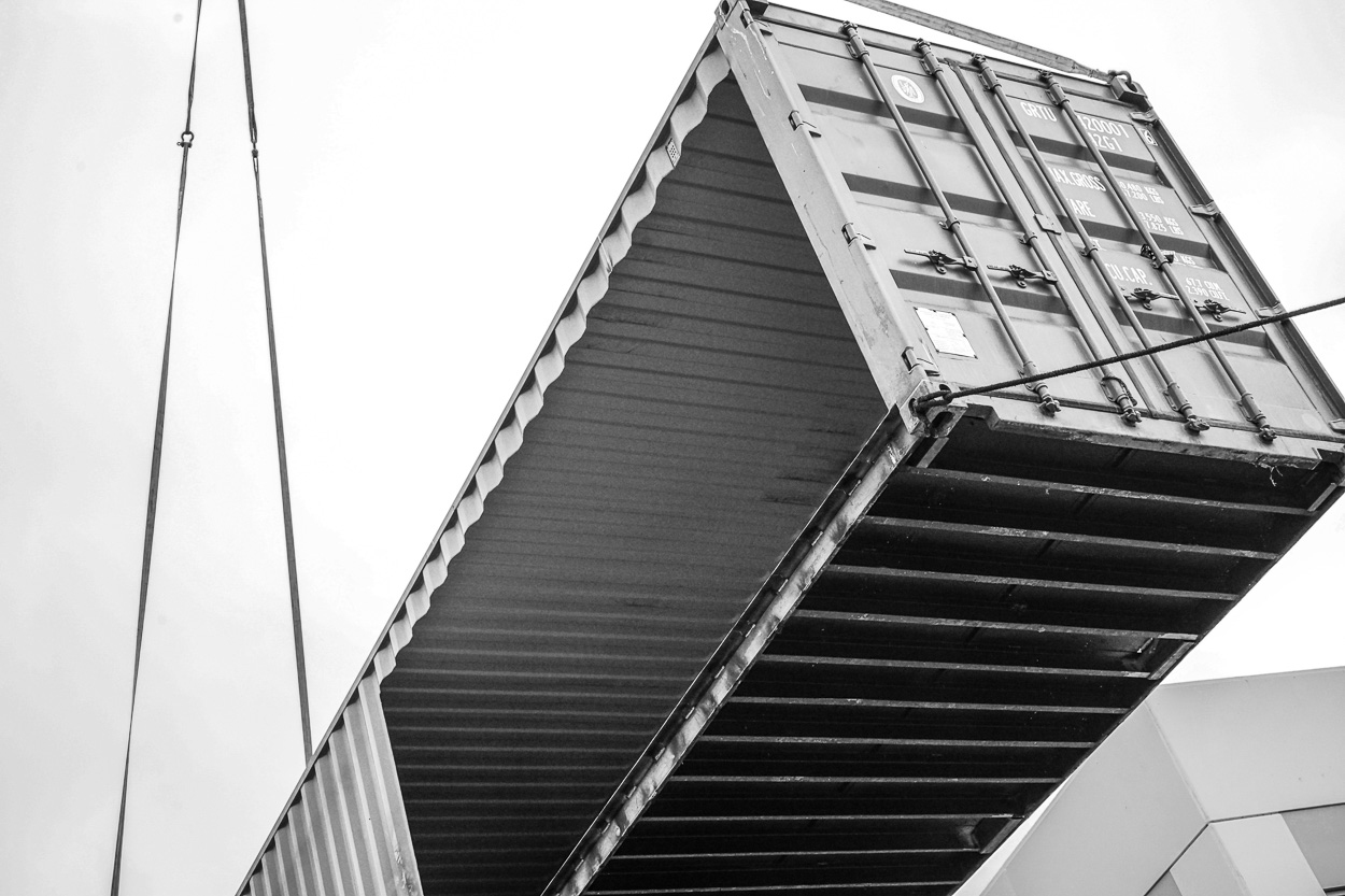 Container Pavilion at Intersect-18-shipping container being craned in