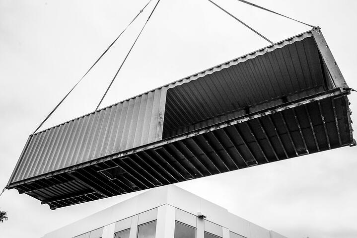 Container Pavilion at Intersect-19-shipping container being craned in