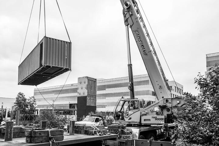Container Pavilion at Intersect-20-shipping container being craned in