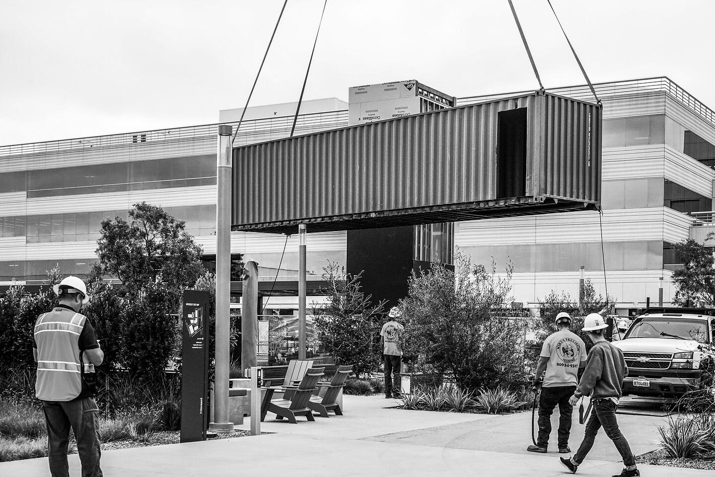 Container Pavilion at Intersect-21-shipping container being craned in