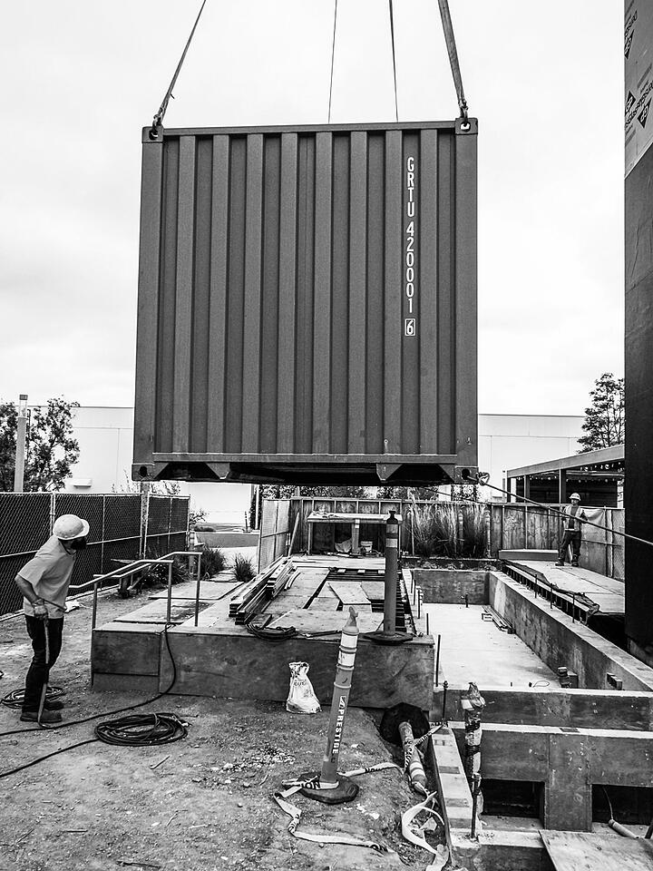 Container Pavilion at Intersect-22-shipping container being craned in