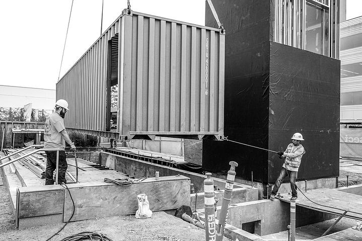 Container Pavilion at Intersect-23-shipping container being craned in