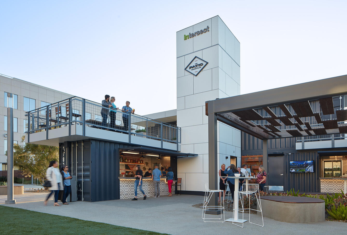 Container Pavilion at Intersect-Hero@2x-people enjoying refreshments from tenant spaces and upper patio