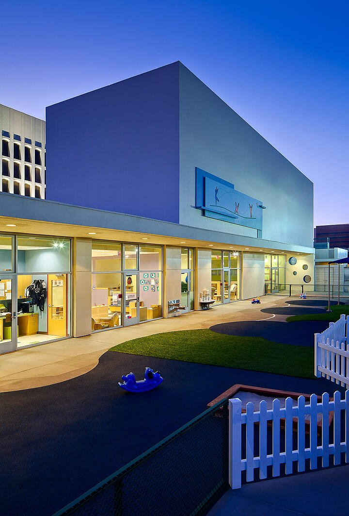 UCLA Child Care Center-@2x-9a-Front entrance and outdoor play area at dusk vertical